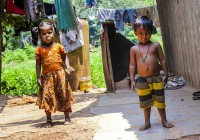Small girl and boy in Indian slum